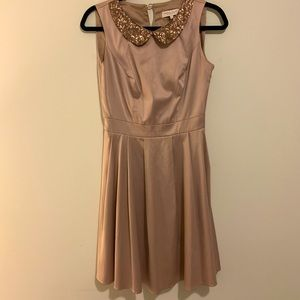 Satin sand colored skater dress with sequin collar